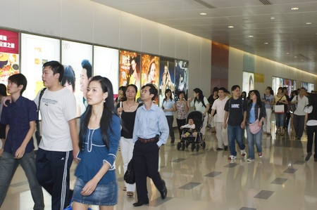 passerby: CHINA, GUANGDONG, SHENZHEN - MAY 1, 2009: Labour Holidays in China, thousands of people shopping in city center. Hard working Chinese trying to make use of one day holiday. Editorial