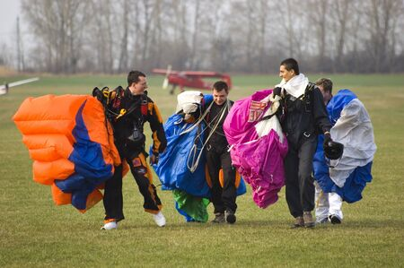 wroclaw: WROCLAW, POLAND - APRIL 3: Undefined parachute jumpers start new season on April 3, 2011. Team goes back after successful landings.