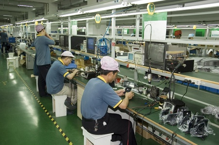 electronics industry: CHINA, SHENZHEN - APRIL 20: The biggest CCTV, surveillance camera producer in China, factory tour on April 20, 2010 in Shenzhen. Editorial