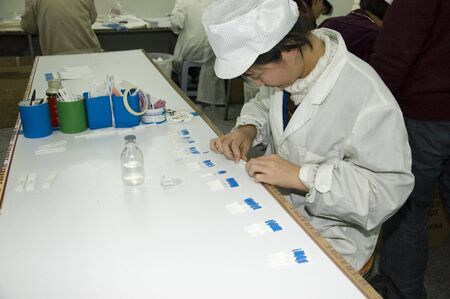 manufactor: CHINA, SHENZHEN - DECEMBER 18: pregnancy test production in China, factory tour on December 18, 2009 in Shenzhen.