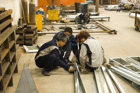 canton: CANTON, CHINA - MARCH 7: Factory in Guangzhou - workers prepare aluminum profile. Factory tour on March 7, 2011.