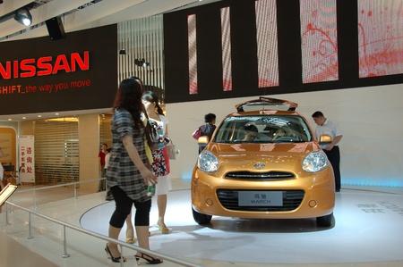 CHINA, SHENZHEN - JUNE 14: Shenzhen-Hong Kong-Macao Auto Show, Chinese visitors watching Nissan on June 14, 2010 in Shenzhen.
