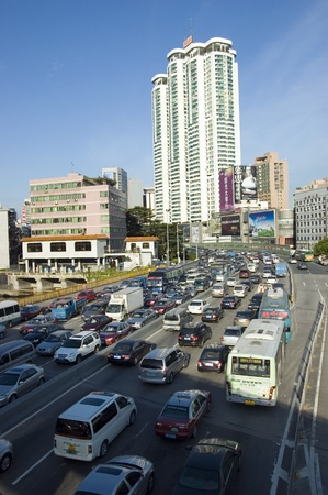 overpopulation: CHINA, SHENZHEN - JULY 1: overpopulated city with huge traffic jam on main road on JULY 1, 2010 in Shenzhen.