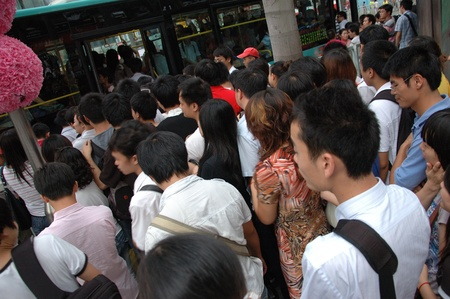 overpopulated: CHINA, SHENZHEN - AUGUST 20: overpopulated city in Guangdong province. Crowd of people in city center waits in queue and pushes to the buses after work on August 20, 2010. Editorial