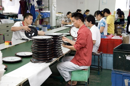 factory worker: CHINA, SHENZHEN - MAY 7: Shenzhen clock factory, almost all Worlds clock are made in Shenzhen, factory tour on MAY 7, 2010 in Shenzhen.