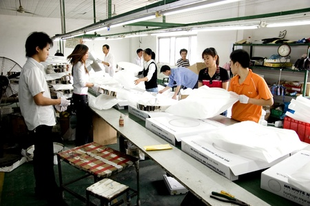 shenzhen: CHINA, SHENZHEN - MAY 7: Shenzhen clock factory, almost all Worlds clock are made in Shenzhen, factory tour on MAY 7, 2010 in Shenzhen.