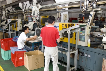 CHINA, SHENZHEN - MAY 7: Shenzhen clock factory, almost all Worlds clock are made in Shenzhen, factory tour on MAY 7, 2010 in Shenzhen.