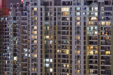 balcony window: CHINA, SHENZHEN - MAY 1: overpopulated city by night, thousands of residential houses, cityscape on MAY 1, 2010 in Shenzhen.