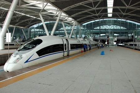 Guangzhou: GUANGZHOU, CHINA - SEPTEMBER 29: China invests in fast and modern railway, trains with speed over 340 kmh. Train to Wuhan on September 29, 2010 waits in newly build Guangzhou South station. Editorial