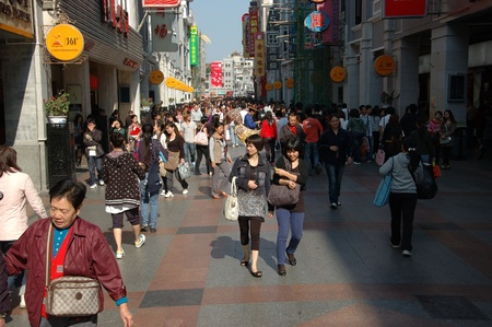 CANTON, CHINA - OCTOBER 28: Shangxiajiu Pedestriant Street in Guangzhou on October 28, 2010. Famous shopping street with many shops and restaurants was reconstructed for Asia Games 2010.   Editorial