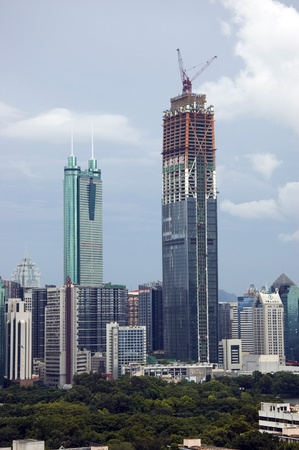 hing: SHENZHEN, CHINA - SEPTEMBER 14: Two, highest skyscrapers in Shenzhen on September 14, 2010. Shun Hing Square, named also as DiWang - 384 meters and Kingkey Finance Tower – 441 meters, still under construction.