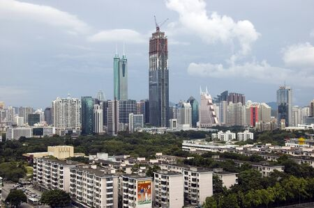 hing: SHENZHEN, CHINA - SEPTEMBER 14: Two, highest skyscrapers in Shenzhen on September 14, 2010. Shun Hing Square, named also as DiWang - 384 meters and Kingkey Finance Tower � 441 meters, still under construction.