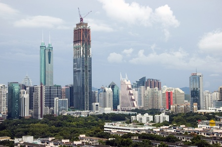 SHENZHEN, CHINA - SEPTEMBER 14: Two, highest skyscrapers in Shenzhen on September 14, 2010. Shun Hing Square, named also as DiWang - 384 meters and Kingkey Finance Tower – 441 meters, still under construction. Stock Photo - 9350472