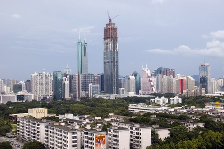 SHENZHEN, CHINA - SEPTEMBER 14: Two, highest skyscrapers in Shenzhen on September 14, 2010. Shun Hing Square, named also as DiWang - 384 meters and Kingkey Finance Tower – 441 meters, still under construction. Stock Photo - 9350465