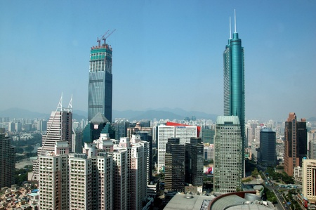 SHENZHEN, CHINA - OCTOBER 31: Two, highest skyscrapers in Shenzhen on October 31, 2010. Shun Hing Square, named also as DiWang - 384 meters and Kingkey Finance Tower – 441 meters, still under construction. 新聞圖片