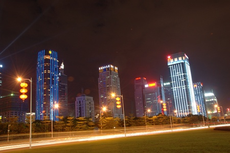 futian: SHENZHEN, CHINA - AUGUST 26: Futian Central Business District at night on August 26, 2010. City center and civic center decorated and illuminated for 30th years anniversary of Shenzhen city. Editorial