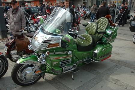 WROCLAW, POLAND - April 16: Motorcycle parade and season opening in Poland. Riders gather to enjoy new season and collect blood for children in hospitals. Green Honda Goldwing on April 16, 2011.