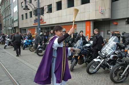 WROCLAW, POLAND - April 16: Motorcycle parade and season opening in Poland. Riders gather to enjoy new season and collect blood for children in hospitals. Priest blessing on April 16, 2011.