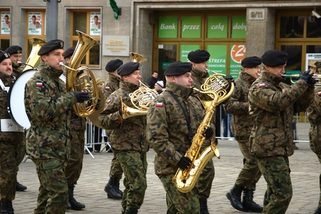 joins: WROCLAW, POLAND - DECEMBER 2: Polish army, engineering training center for troops receives new army banner. Army orchestra joins the parade on December 2, 2011.