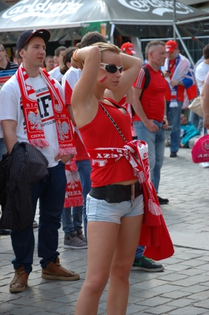 uefa: WROCLAW, POLAND - JUNE 8: UEFA Euro 2012, fanzone in Wroclaw. Pretty Polish girl waiting for first game on June 8, 2012.