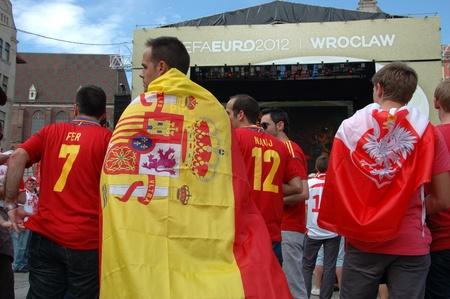 WROCLAW, POLAND - JUNE 8: UEFA Euro 2012, fanzone in Wroclaw. Spanish fan with big flag on June 8, 2012.