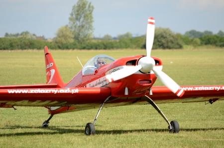 SZYMANOW, POLAND - AUGUST 25: Pilot Piotr Haberland arrives back after acrobatic show in plane Zlin-50 LS on August 25, 2012 in Szymanow. Sajtókép