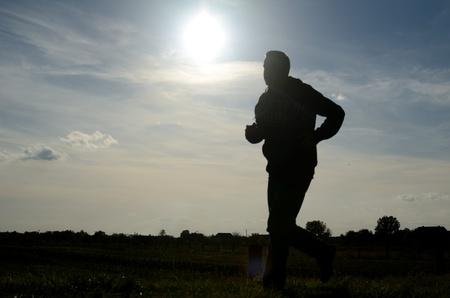 Figure of silhouette jogging runner.