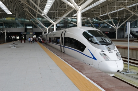 wuhan: SHENZHEN, CHINA - SEPTEMBER 9:  Fast train starts from Shenzhen to Wuhan on September 9, 2012. With speed 300kmh train arrives Wuhan within 5 hours. Editorial