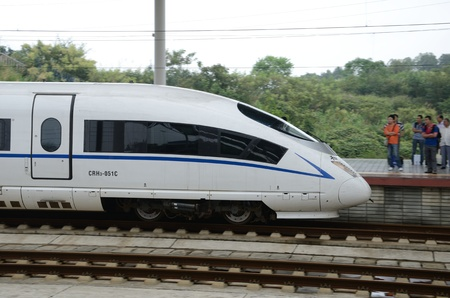 wuhan: YUEYANG, CHINA - SEPTEMBER 9:  Fast train between Shenzhen and Wuhan stops in YueYang railway station on September 9, 2012.