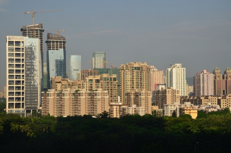 futian: SHENZHEN, CHINA - SEPTEMBER 14:  Modern Shenzhen city, Futian district with new and old residential buildings on September 14, 2012. Within 30 years Shenzhen became modern business metropolis. Editorial