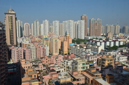 futian: SHENZHEN, CHINA - SEPTEMBER 16:  Modern Shenzhen city, Futian district with new and old residential buildings on September 16, 2012. Within 30 years Shenzhen became modern business metropolis. Editorial