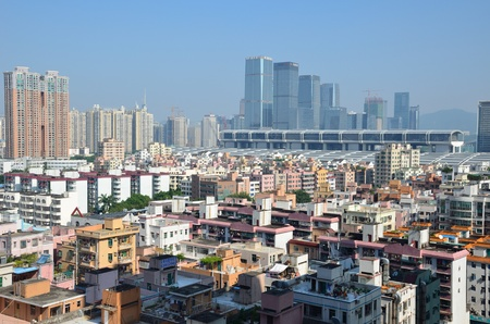 futian: SHENZHEN, CHINA - SEPTEMBER 16:  Modern Shenzhen city, Futian district with old residential buildings and new exhibition center on September 16, 2012. Within 30 years Shenzhen became modern business metropolis.