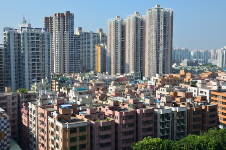 SHENZHEN, CHINA - SEPTEMBER 16:  Modern Shenzhen city, Futian district with new and old residential buildings on September 16, 2012. Within 30 years Shenzhen became modern business metropolis. Stock Photo - 16994493