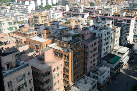futian: SHENZHEN, CHINA - SEPTEMBER 16:  Modern Shenzhen city, Futian district with old residential buildings on September 16, 2012. Within few years old houses will be replaced with modern skyscrapers.