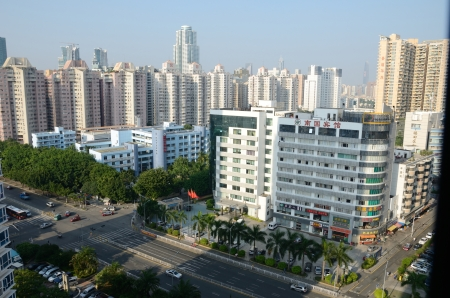 futian: SHENZHEN, CHINA - SEPTEMBER 16:  Modern Shenzhen city, Futian district. Cityscape with hotels, school and hospital on September 16, 2012.  Editorial