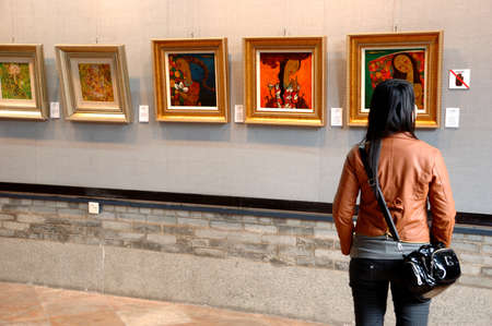 CANTON, CHINA - MARCH 8, 2011: Unidentified person admires Chinese paintings inside Chen Clan Ancestral Hall on 8th March in Guangzhou, China. Editorial