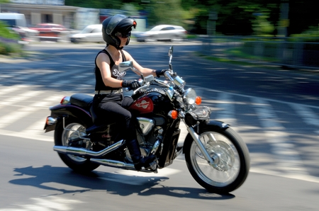 joins: WROCLAW, POLAND - JULY 4: Unidentified female rider joins Eleven Bike Fest motor parade arranged by Harley-Davidson Club on 4th July 2015 in Wroclaw, Poland. Editorial