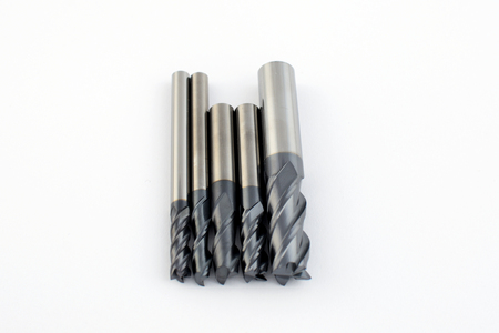 carbide: Professional cutting tools. Few metallic carbide endmills, different size used for metalwork.