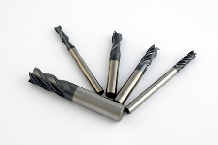 Professional cutting tools. Few metallic carbide endmills, different size used for metalwork.