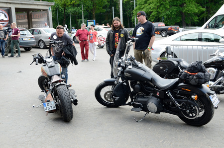 gather: WROCLAW, POLAND - MAY 21: Unidentified motorcyclists gather for Eleven Bike Fest and admire their Harley-Davidson motors on 21 May 2016 in Wroclaw.