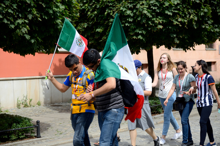 WROCLAW, POLAND - JULY 23: Unidentified group of pilgrims join Days In Dioceses to prepare just before The World Youth Day in Cracow. Pilgrims from Mexico walk from Cathedral on July 23rd 2016 in Wroclaw.