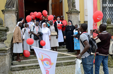 nuns: TRZEBNICA, POLAND - JULY 25: World Youth Day, Polish and Senegal nuns take photo together in front of St. Jadwiga Sanctuary on 25th July 2016 in Trzebnica.