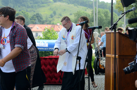 oft: TRZEBNICA, POLAND - JULY 25: World Youth Day, dancing priest in front oft St. Jadwiga Sanctuary on 25th July 2016 in Trzebnica. Editorial