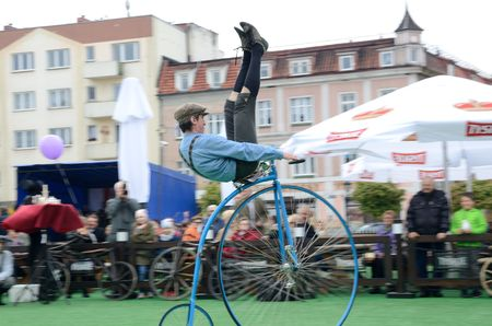 MILICZ, LOWER SILESIA, POLAND - MAY 3: Constitution Day in Poland. Performance on stage about history of bicycles. Cyclists from group Bicykle.pl from Lodz city shows old bicycles. Copy of English bicycle from XIX century. Cyclist performs tricks on bicyc