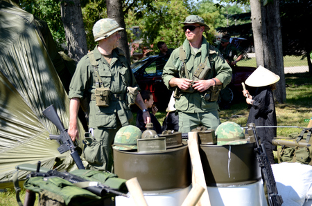 WROCLAW, POLAND - JUNE 3: Reconstruction groups rally. Militarians fan gathering, people in uniforms, historical vehicles and weapons. Men in US Army uniforms and weapon from Vietnam War on June 3rd 2017 in Wroclaw..