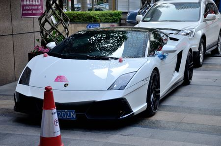 SHENZHEN, CHINA - APRIL 3. Modern Lamborghini in front of Marco Polo hotel in Futian district on April 3rd, 2018.