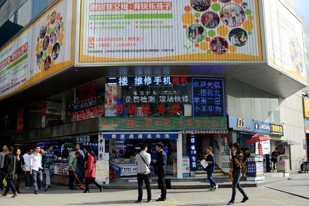 SHENZHEN, CHINA - APRIL 3: SEG famous electronic market in HuaQiangBei road. People walks in front of main entrance on April 3rd, 2018. Sajtókép