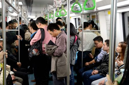 SHENZHEN, CHINA - APRIL 3: Inside metro train. Most people busy with their smartphones on April 3rd, 2018.