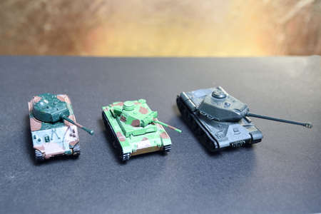Glued toys - plastic tanks from 2nd World War. Russian and American tank and German flame thrower.