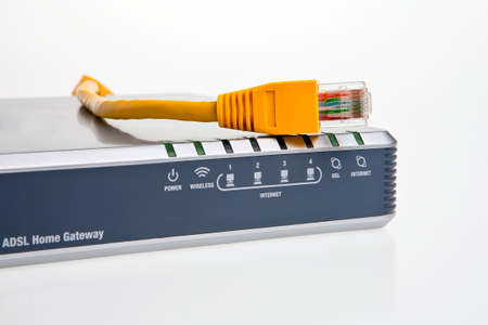 adsl: ADSL internet modemrouter, front panel displays with yellow patch cord. Stock Photo